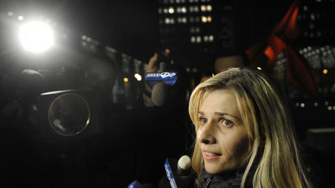 Bartender Karolina Obrycka, who was beaten in February 2007 by off-duty Chicago police officer Anthony Abbate, talks to the media while leaving the Dirksen Federal building after she was awarded $850,000 in damages by jurors in Chicago, Tuesday, Nov. 13, 2012. Surveillance video of the hulking Abbate pushing Obrycka to the ground behind the bar at Jesse's Shortstop Inn, then repeatedly punching and kicking her, went viral online. (AP Photo/Paul Beaty)