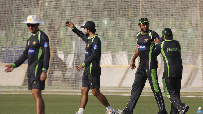 Pakistani cricket players take part in a net practice to play against Zimbabwe at the Gaddafi stadium in Lahore, Pakistan, Wednesday, May 20, 2015. Zimbabwe is the first test playing nation to visit Pakistan in more than six years since gunmen attacked on a bus for the Sri Lanka team in Lahore in 2009. (AP Photo/K.M. Chaudary)