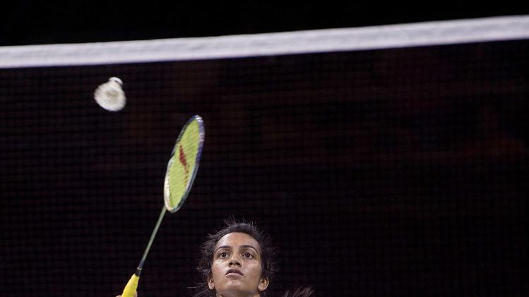 India's Sindhu plays a shot against Spain's Marin during their semi-final match at the Badminton World Championship in Copenhagen