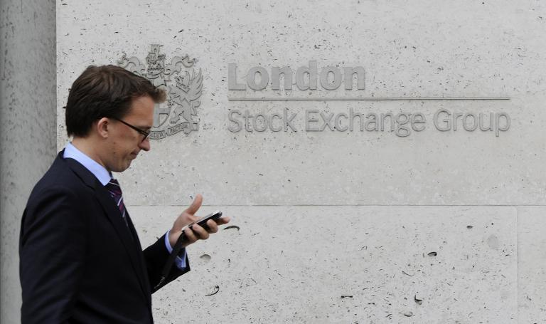 London shares close flat after hitting new intraday high