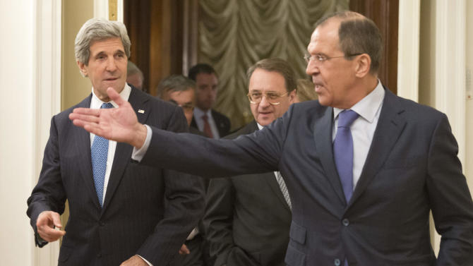Russian Foreign Minister Sergey Lavrov, right, gestures as he greets U.S. Secretary of State John Kerry, left, during their meeting in Moscow, Russia, Tuesday, May 7, 2013. Secretary of State John Kerry on Tuesday argued the U.S. case to Russian President Vladimir Putin for Russia to take a tougher stance on Syria at a time when Israel's weekend air strikes against the beleaguered Mideast nation have added an unpredictable factor to the talks.  (AP Photo/Misha Japaridze)