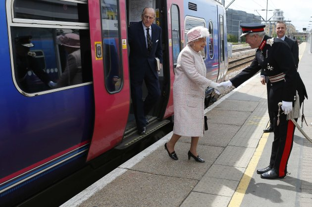 Britain's Queen Elizabeth is greeted by Lord Lieutenant Hugh Duberly after stepping off a train to start a visit to Cambridge