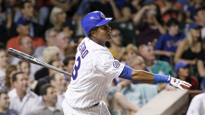 Chicago Cubs' Starlin Castro watches his home run off Washington Nationals relief pitcher Tyler Clippard during the eighth inning of a baseball game Tuesday, Aug. 9, 2011, in Chicago. (AP Photo/Charles Rex Arbogast)