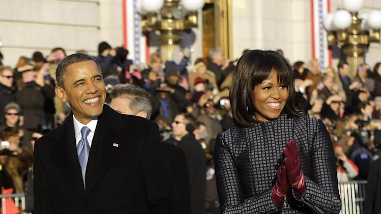 President Barack Obama and first lady Michelle Obama walk in the Inaugural Parade during the 57th Presidential Inauguration in Washington, Monday, Jan. 21, 2013. (AP Photo/Charles Dharapak)