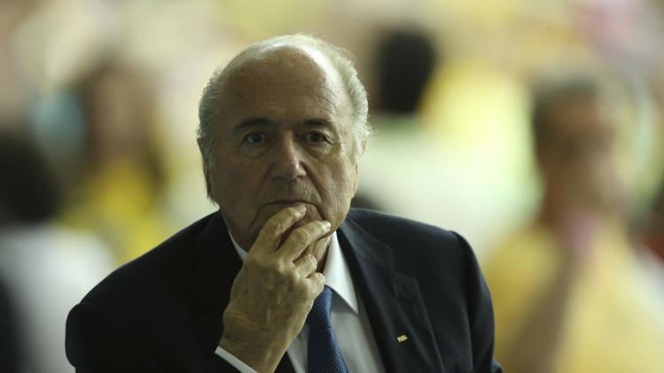 FIFA President Joseph Blatter arrives for the soccer Confederations Cup final between Brazil and Spain at the Maracana stadium in Rio de Janeiro, Brazil, Sunday, June 30, 2013. (AP Photo/Eugene Hoshiko)