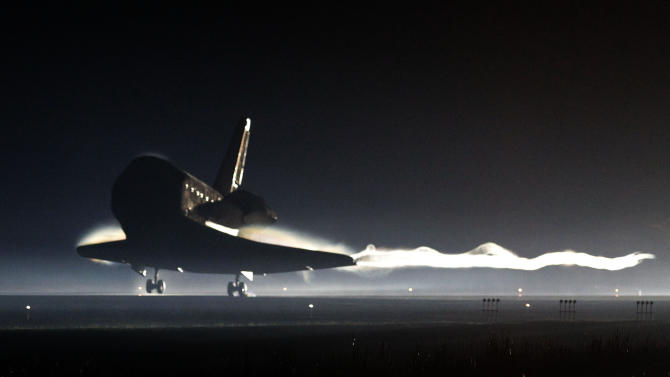 Space Shuttle Atlantis lands at the Kennedy Space Center at Cape Canaveral, Fla. Thursday, July 21, 2011. The landing of Atlantis marks the end of NASA's  30 year space shuttle program.  (AP Photo/Pierre Du Charme, Pool)