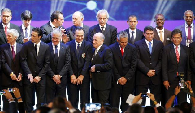 FIFA President Sepp Blatter takes part in a group photo with the coaches of the national teams after the draw for the 2014 World Cup finals was made at the Costa do Sauipe resort in Sao Joao da Mata