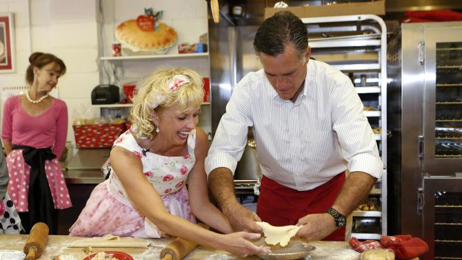 U.S. Republican Presidential candidate Mitt Romney makes a pie while he visits bakery in Michigan