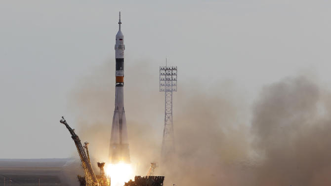 The Soyuz-FG rocket booster with Soyuz TMA-05M space ship carrying a new crew to the International Space Station, ISS, blasts off from the Russian leased Baikonur cosmodrome, Kazakhstan, Sunday, July 15, 2012. The Russian rocket carries Russian cosmonaut Yuri Malenchenko, U.S. astronaut Sunita Williams and Japanese astronaut Akihiko Hoshide. (AP Photo/Dmitry Lovetsky)