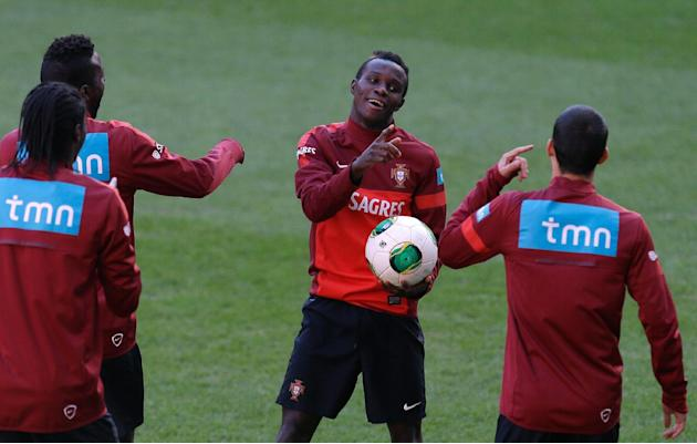 Portugal's Bruma, center, jokes with his teammates during a training session Sunday, Nov. 17 2013, at the Luz stadium in Lisbon. Portugal will play Sweden Tuesday in a World Cup qualifying playoff sec
