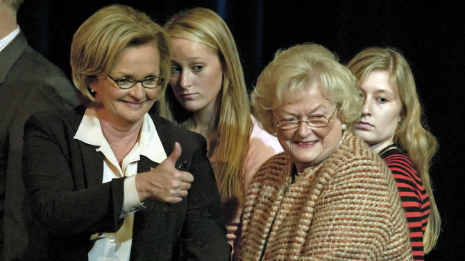 "FILE - In this Oct. 11, 2006 file photo, then-candidate for U.S. Senate Claire McCaskill, left, gives the thumbs up to supporters as she holds the hand of her mother, Betty Anne McCaskill, after her debate against incumbent Sen. Jim Talent at Clayton high school in Clayton, Mo. McCaskill's campaign said that 84-year-old Betty Anne Ward McCaskill died Monday, Oct. 29, 2012 at her home in St. Louis. The Democratic senator had said Saturday that her mother suffered from ""acute cardio-renal failure"" and had lost consciousness at several points in recent days. (AP Photo/Tom Gannam, File)"