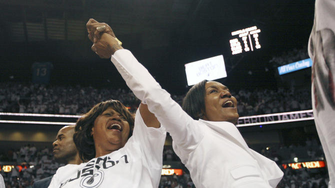 Dwyane Wade's mother, Jolinda Wade, left, and LeBron James' mother, Gloria James, celebrate during the second half of  Game 5 of a second-round NBA playoff basketball series in Miami, Wednesday, May 11, 2011. The Heat won 97-87 to advance to the Eastern Conference finals. (AP Photo/J Pat Carter)