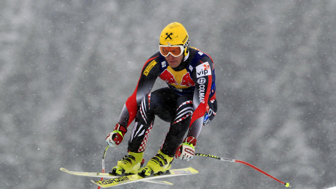 Croatia's Ivica Kostelic is airborne as he speeds on his way to clock the seventh fastest time during a training session for Saturday's alpine ski, men's World Cup downhill race,  in Kitzbuehel, Austria, Thursday, Jan. 20, 2011. (AP Photo/Alessandro Trovati)