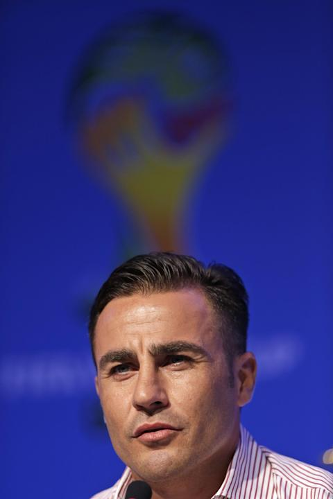 Former soccer great and World Cup winner Fabio Cannavaro of Italy answers a question during a press conference one day before the draw for the 2014 soccer World Cup in Costa do Sauipe near Salvador, B