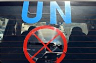 The United Nations monitors team leaves the UN headquarters in Damascus on a new tour of Syria's flashpoint areas on May 14