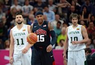 US forward Carmelo Anthony (C) Lithuanian forward Simas Jasaitis (R) and forward Linas Kleiza during their Olympic basketball match. Anthony scored 20 points as the Americans remained unbeaten despite a 25-point effort from Lithuanian captain Kleiza of the NBA Toronto Raptors