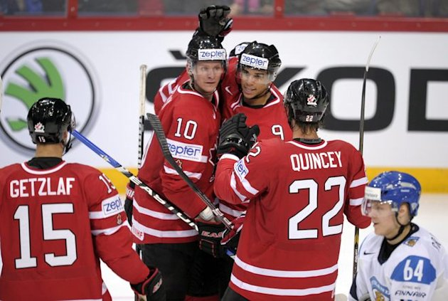 Canada's Ryan Getzlaf (L), Corey Perry, Evander Kane And Kyle Quincey Celebrate 