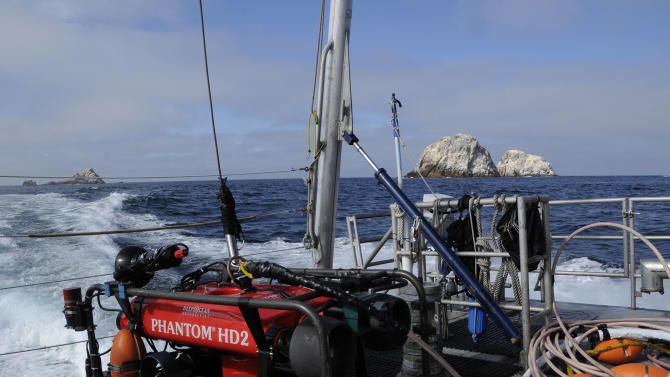In this Friday, Sept. 12, 2014 photo provided by the National Oceanic and Atmospheric Administration, an undersea robot is shown on the deck of the NOAA research vessel Fulmar near the Farallon Islands, 30 miles off the coast from San Francisco. Federal researchers are exploring more than a dozen underwater sites where they believe ships sank in the treacherous waters outside the Golden Gate in the decades following the Gold Rush. During a five-day expedition, a team from NOAA used sonar and an underwater vehicle to examine and photograph the historic shipwrecks in the Gulf of the Farallones Marine Sanctuary, where more than 300 vessels are believed to have sunk. (AP Photo/NOAA)