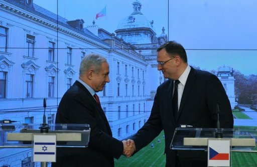 <p>Israel's Prime Minister Benjamin Netanyahu (L) shakes hands with Czech Prime Minister Petr Necas after their press conference on December 5, in Prague. Netanyahu braced for tense talks with German Chancellor Angela Merkel on Thursday as plans to build thousands of new Jewish settler homes strained ties with key allies.</p>