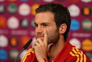Juan Mata, pictured in June 2012, wants Spain to make yet more football history by becoming the first nation to hold the world, European and Olympic titles at the same time with victory at London 2012