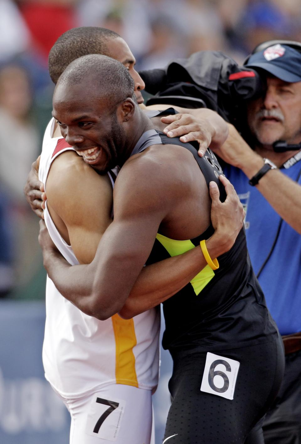 LaShawn Merritt hugs Bryshon Nellum after the men's 400m finals at the U.S. Olympic Track and Field Trials Sunday, June 24, 2012, in Eugene, Ore. (AP Photo/Marcio Jose Sanchez)