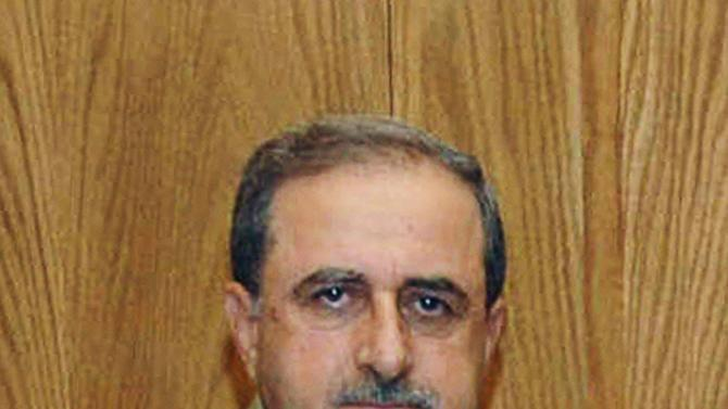 This undated photo released by the Syrian official news agency SANA, shows Syrian Defense Minister Gen. Dawoud Rajha in Damascus, Syria. Syria's state-run TV says the country's defense minister has been killed in a suicide blast in the capital. Wednesday's attack struck the National Security building in Damascus during a meeting of Cabinet ministers and senior security officials. (AP Photo/SANA)