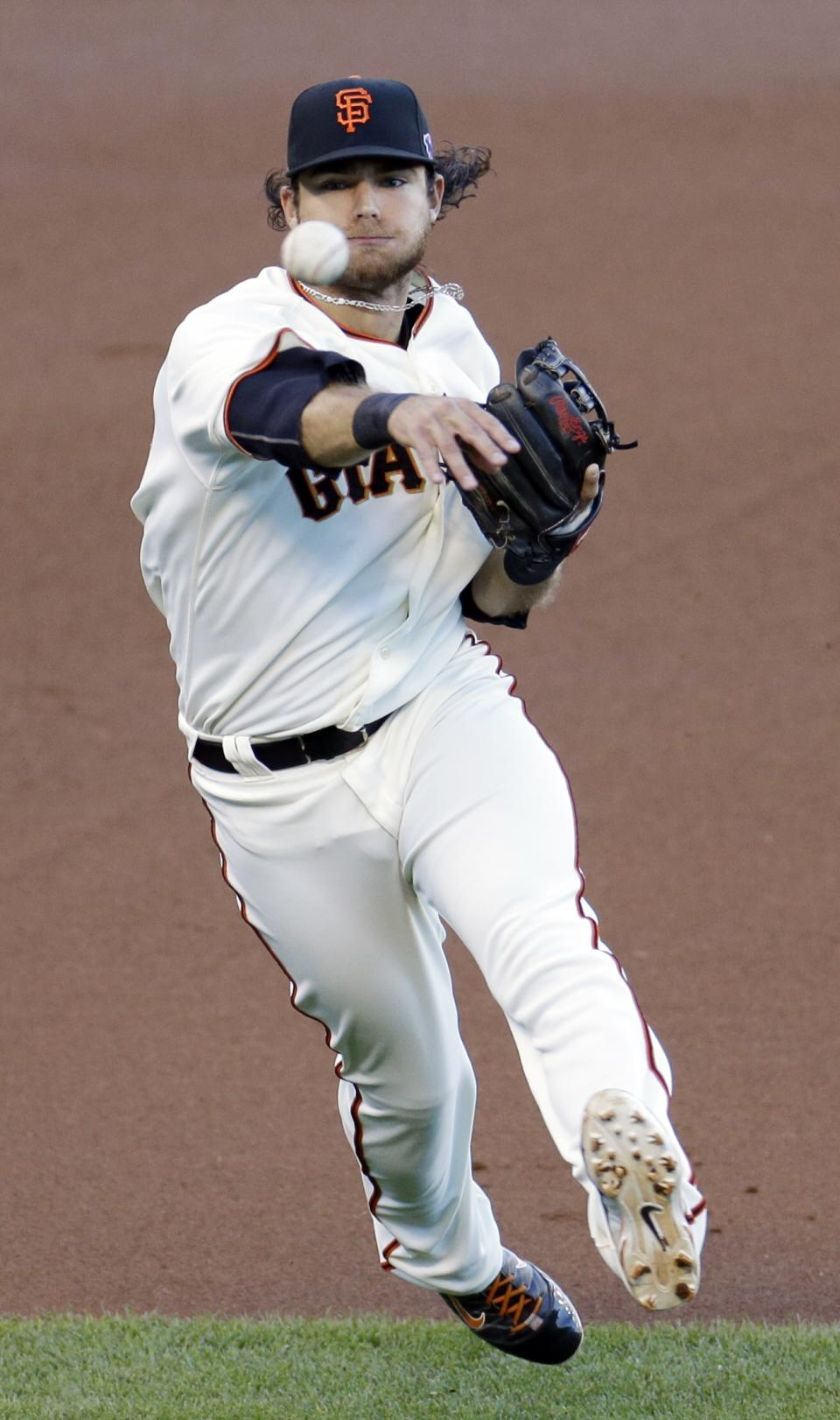 San Francisco Giants' Brandon Crawford makes a play on a ball hit by St. Louis Cardinals' Yadier Molina during the first inning of Game 2 of baseball's National League championship series Monday, Oct. 15, 2012, in San Francisco. (AP Photo/Eric Risberg)