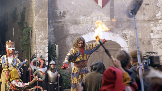 "In this photo taken Monday, Oct. 29, 2012, actors perform during the shooting of ""Borgia"" tv series in Sermoneta, Italy.   The Italian economy may be struggling but the pan-European television series ""Borgia,"" which is now filming its second season in Italy, is a thriving hit on the world market. Spanning the late Middle Ages to the early Renaissance period, the show follows the famous Borgia family's rise to power and subsequent domination of the Vatican and southern Europe's political landscape. A winning combination of sex, violence, faith, lust and betrayal, the primarily French-German production has been sold in 85 countries worldwide.  (AP Photo/Gregorio Borgia)"