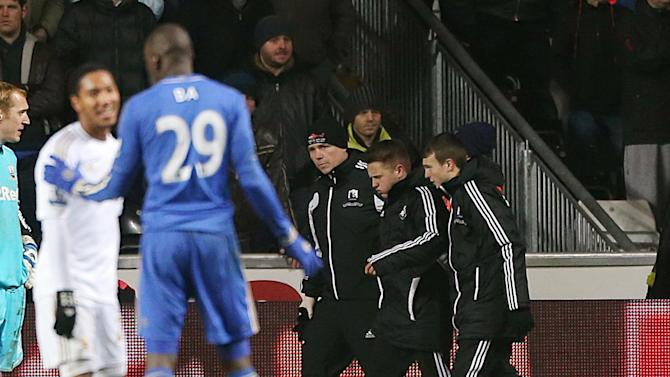A ball boy, second right, is ushered away from the sidelines following an incident with Chelsea's Eden Hazard, not pictured, during the English League Cup second leg semi-final soccer match between Chelsea and Swansea City at the Liberty Stadium, Swansea, Wales, Wednesday Jan. 23, 2013. Hazard was shown the red card following the incident. (AP Photo/PA, Nick Potts) UNITED KINGDOM OUT  NO SALES  NO ARCHIVE