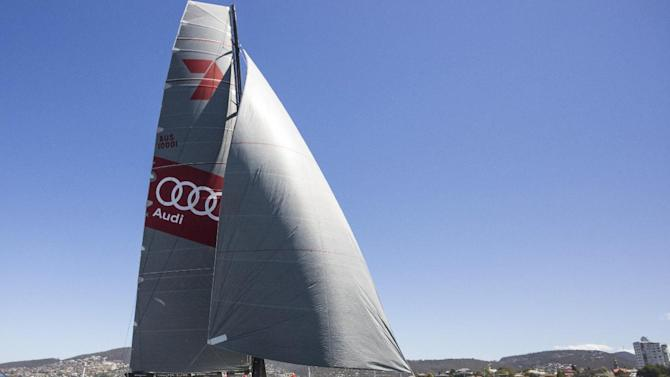 Wild Oats XI crosses the finish line to take line honors in the Sydney Hobart yacht race in Hobart, Australia, Sunday, Dec. 28, 2014. Australian-owned Wild Oats crossed the finish line to complete the 70th edition of the blue water classic in an unoffical time of 2 days, 2 hours and 2 minutes. (AP Photo/AAP Image, Heath Holden) NO ARCHIVE, EDITORIAL USE ONLY, AUSTRALIA OUT, NEW ZEALAND OUT, PAPUA NEW GUINEA OUT, SOUTH PACIFIC OUT