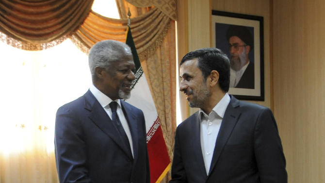 """In this photo released by the semi-official Iranian Students News Agency (ISNA), International envoy Kofi Annan, left, shakes hands with Iranian President Mahmoud Ahmadinejad, at the beginning of their meeting on the Iranian island of Qeshm, Wednesday, April 11, 2012. Annan, the U.N.-Arab League envoy, has been pushing Damascus to withdraw its troops from cities and halt all violence in 48 hours to salvage his peace plan. He has appealed to Syria's key ally Iran to support his plan to end the violence wracking the Arab country, saying that """"any further militarization of the conflict would be disastrous.""""  (AP Photo/ISNA, Hamid Foroutan)"""