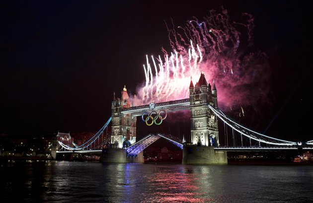 Fireworks explode off the Tower Bridge during the night of the opening ceremony of London 2012 Olympic Games in London