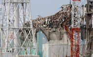 The No. 3 reactor building, pictured in May, at the stricken Fukushima nuclear power plant. Former prime minister Yukio Hatoyama joined an anti-nuclear march on Friday to the prime minister&#39;s official residence