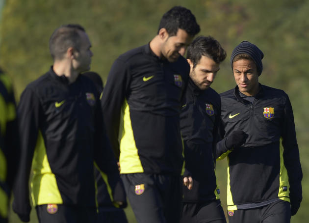 FC Barcelona's Neymar, from Brazil, right, Cesc Fabregas, second right, Sergio Busquets, second left, and Andres Iniesta, left, attend a training session at the Sports Center FC Barcelona Joan Gam