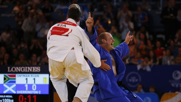 Christopher Sherrington of Scotland celebrates his victory over Ruan Snyman of South Africa in the judo +100kg gold medal contest at the 2014 Commonwealth Games in Glasgow, Scotland