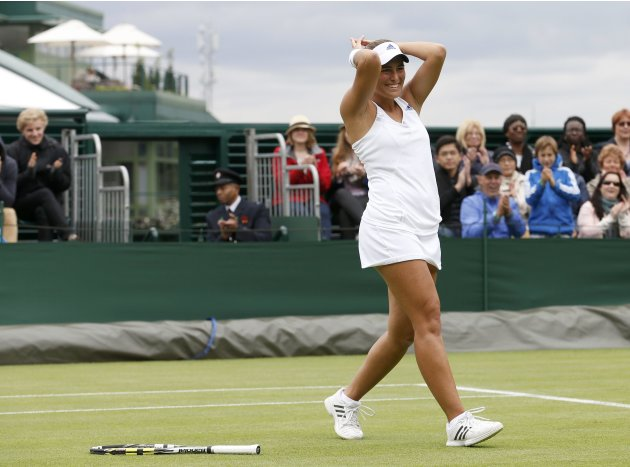 Monica Puig of Puerto Rico celebrates after defeating Sara Errani of Italy in their women's singles tennis match at the Wimbledon Tennis Championships, in London