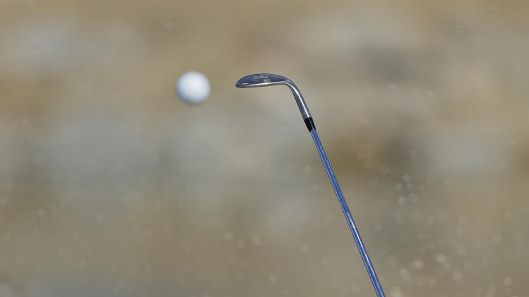 Tim Clark hits out of the bunker to the third green during a third round match against Ian Poulter at the Match Play Championship golf tournament, Saturday, Feb. 23, 2013, in Marana, Ariz. (AP Photo/Julie Jacobson)