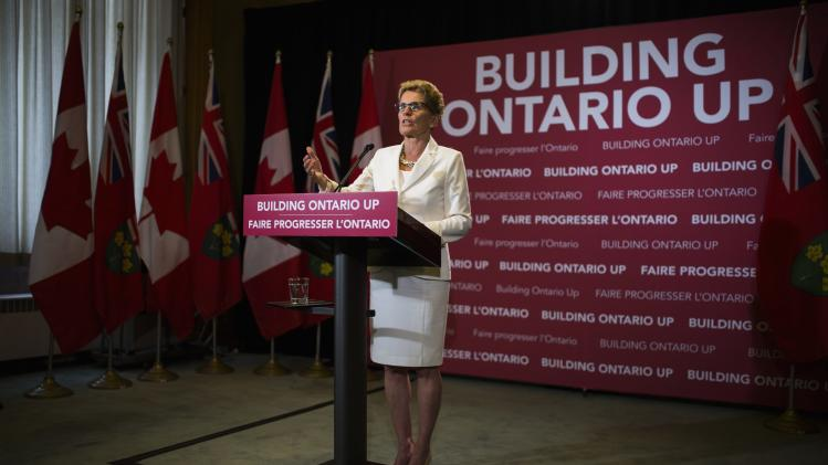 Ontario Premier Kathleen Wynne speaks at a news conference following Lieutenant Governor of Ontario David Onley's throne speech at the Queen's Park Ontario Legislature in Toronto