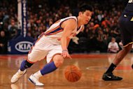 File photo shows Jeremy Lin playing for the New York Knicks in New York in March. Lin's sparkling Broadway run is over, but the point guard who took New York by storm says he is excited to launch the next phase of his NBA career with the Houston Rockets