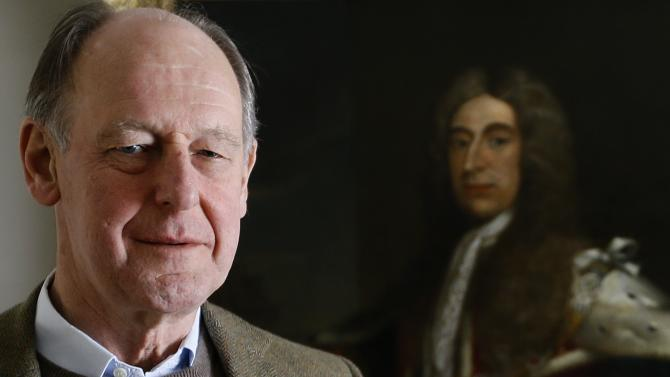 "Timothy Torrington  the 11th Viscount Torrington stands with a painting of his ancestor Admiral Sir George Byng the 1st Viscount Torrington, in Mere, Somerset, England, Monday, April 8, 2013.  Viscount Timothy Torrington's story reads like a real-life version of ""Downton Abbey,"" the hit period drama about the family of an earl who has no direct heir to inherit his title. Like the fictional character Lord Grantham, the aristocrat has three daughters but no sons. In order for his title to live on in future generations, the 69-year-old has no choice but to pass it to a distant relative abroad, someone he has not even met. (AP Photo/Kirsty Wigglesworth)"