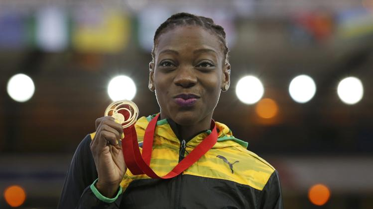 Williams of Jamaica celebrates with her gold medal during the medal ceremony after the Women's Triple Jump at the Commonwealth Games in Glasgow