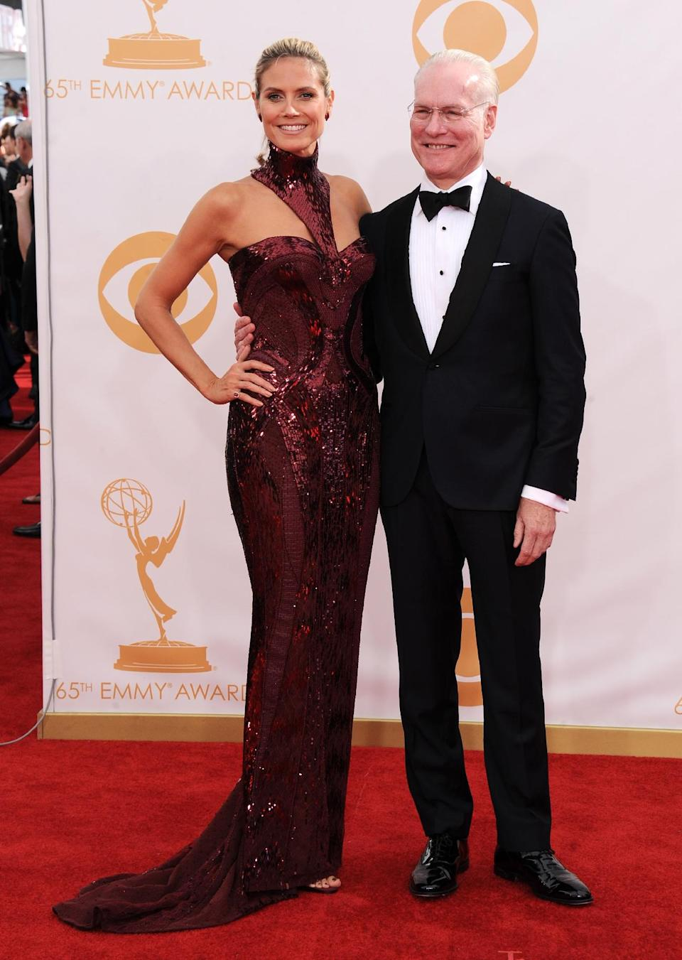 Heidi Klum, wearing Versace, left, and Tim Gunn arrive at the 65th Primetime Emmy Awards at Nokia Theatre on Sunday Sept. 22, 2013, in Los Angeles. (Photo by Jordan Strauss/Invision/AP)