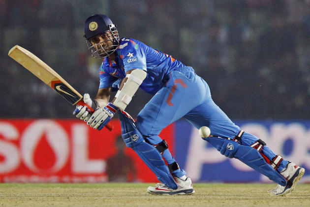 India's Ajinkya Rahane plays a shot during the Asia Cup one-day international cricket tournament against Bangladesh in Fatullah, near Dhaka, Bangladesh, Wednesday, Feb. 26, 2014. India won by 6 wicket