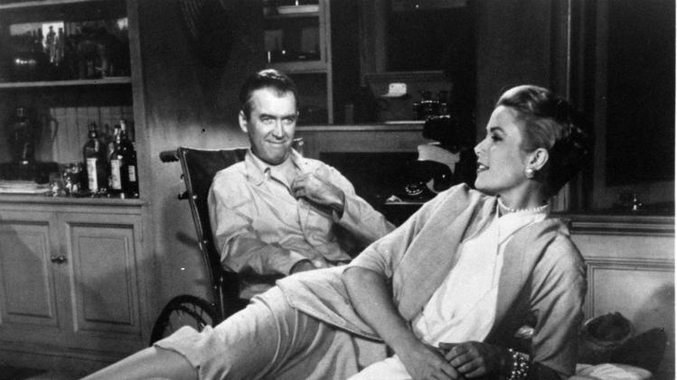 "FILE - In this 1954 file photo, James Stewart and Grace Kelly are shown in Alfred Hitchcock's film, ""Rear Window.""  (AP Photo/Paramount Pictures, file)"