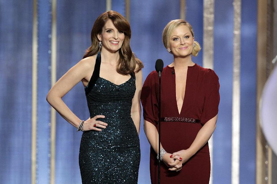 This image released by NBC shows co-host Tina Fey, left, and Amy Poehler on stage during the 70th Annual Golden Globe Awards held at the Beverly Hilton Hotel on Sunday, Jan. 13, 2013, in Beverly Hills, Calif. (AP Photo/NBC, Paul Drinkwater)