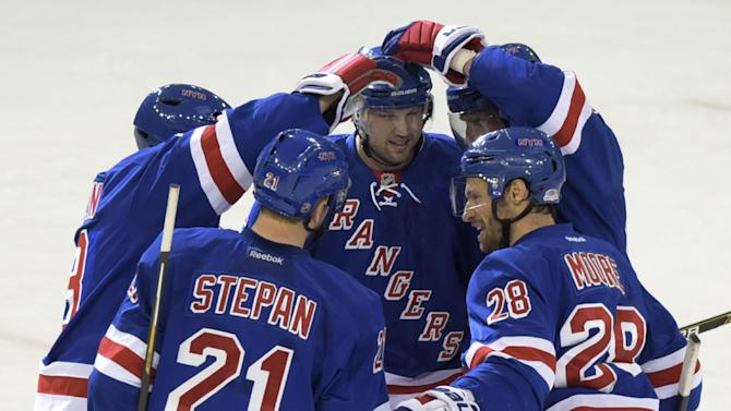 New York Rangers' Rick Nash, center, celebrates his empty-net goal with Kevin Klein, left, Derek Stepan (21) Dominic Moore (28) and Marc Staal, back right, during the third period of an NHL hockey game against the Nashville Predators on Monday, March. 2, 2015, at Madison Square Garden in New York. The Rangers won 4-1. (AP Photo/Bill Kostroun)