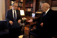 Greek Prime Minister Lucas Papademos (L) meets with Greek President Carolos Papoulias in Athens. Papademos resigned on Wednesday, setting the stage for early elections on May 6 after a five-month rescue mission to save the country from bankruptcy