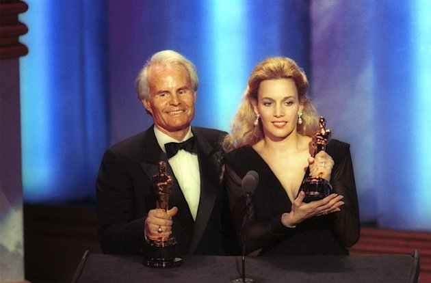 "FILE - In this March 26, 1990 file photo, producers Richard D. Zanuck, and Lili Fini Zanuck accept Oscars for best picture of the year for ""Driving Miss Daisy"" at the 62nd annual Academy Awards in Los Angeles. According to his publicist, Richard D. Zanuck has died at age 77 on Friday, July 13, 2012, in Los Angeles. (AP Photo/Reed Saxon, File)"