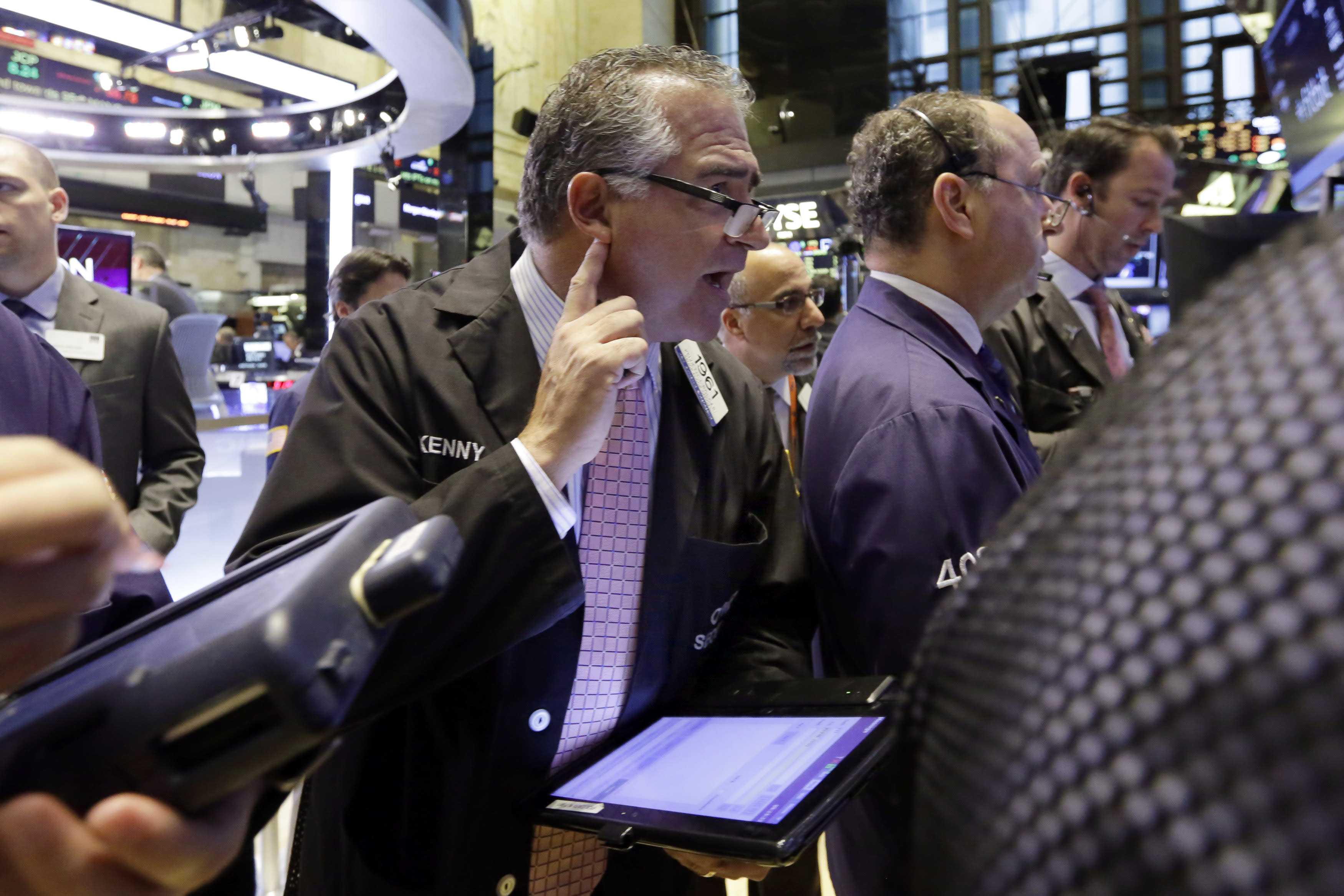 Wall Street dips with health, consumer shares; gains for November