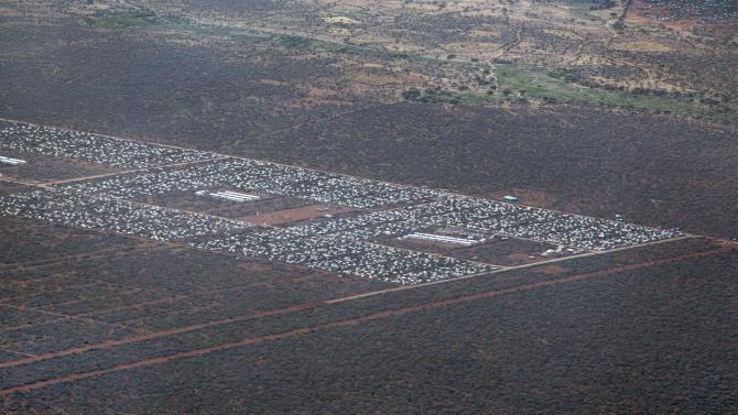 FILE - In this Monday, Feb. 20, 2012 file photo, parts of Dadaab, the world's largest refugee camp, are seen from a helicopter in northern Kenya. Security officials in Kenya say attackers ambushed a convoy of aid workers Friday, June 29, 2012 at Dadaab near the Somali border and kidnapped international and Kenyan workers. (AP Photo/Ben Curtis, File)